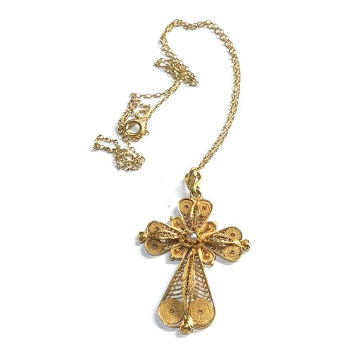 8 - 18k gold filigree cross and chain weight 6.4g...