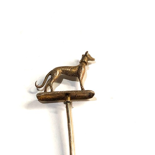 20 - high carat  Gold greyhound stick pin measures approx 9.5cm long, his piece is in good overall condit...