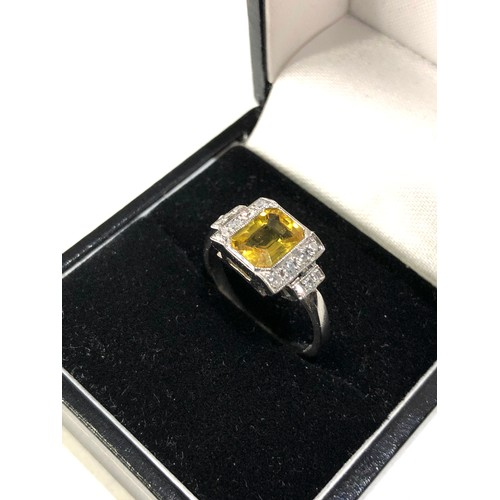 34 - Fine platinum diamond and yellow sapphire ring central yellow sapphire measures approx 7mm by 5.5mm...