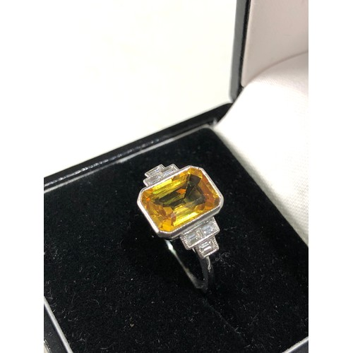 35 - Fine platinum diamond and yellow sapphire ring central yellow sapphire measures approx 11mm by 7mm...