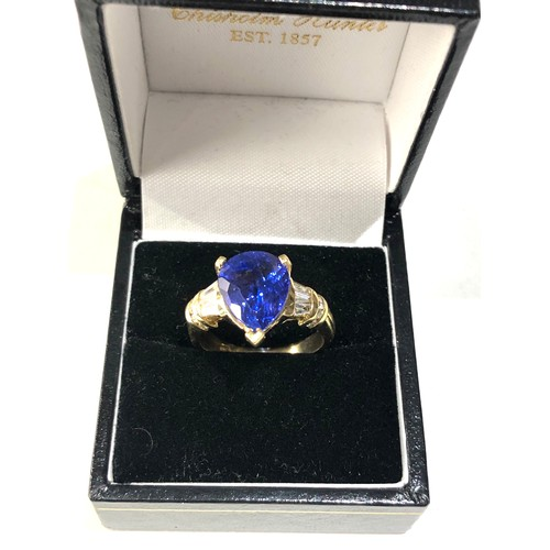 47 - Fine 18ct gold diamond and pear 12mm tanzanite ring central tanzanite measures approx 12mm by 10mm w...