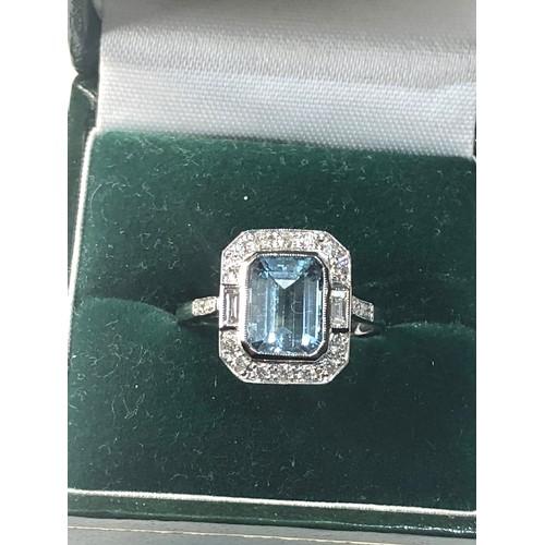 39 - Fine diamond and Aquamarine ring large central aqua is 2.28 ct with diamonds around set in platinum...