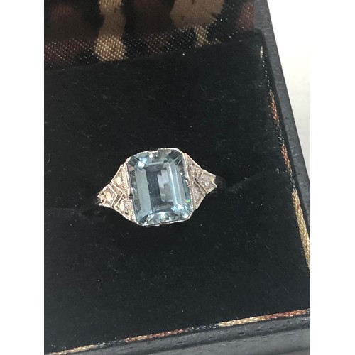 40 - Fine diamond and Aquamarine ring large central aqua is 2.40 ct with diamonds around set in platinum...