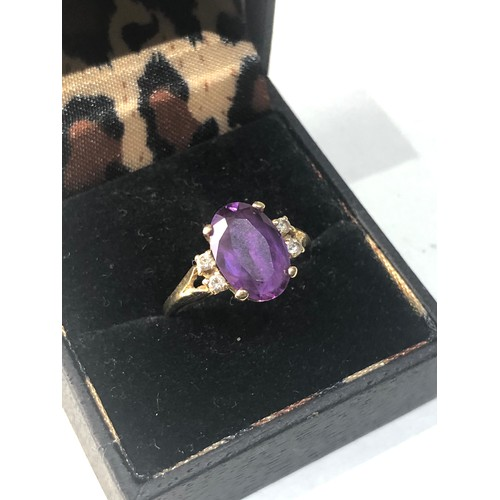 42 - Fine 18ct gold diamond and amethyst ring central sone measures approx 12mm by 8mm weight 4g...