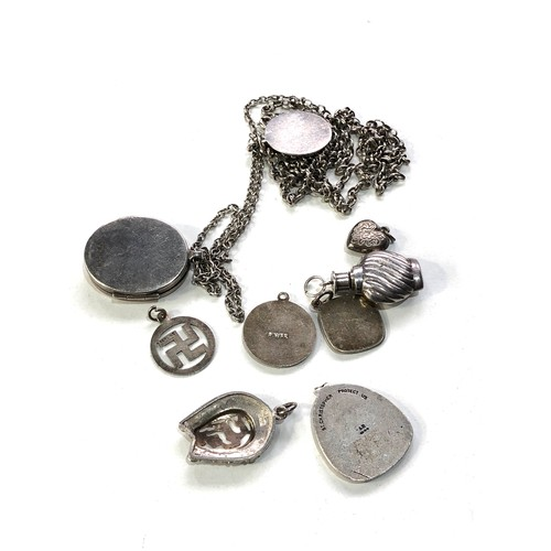 18 - Selection of silver jewellery includes st christophers locket etc...