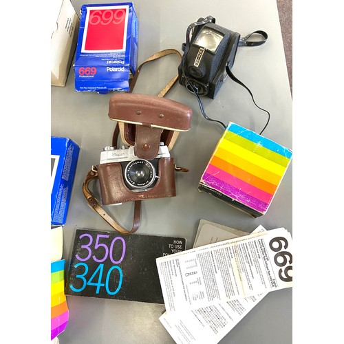 35 - Selection of cameras and cameras equipment to include polaroid 340 and a super halina vintage camera...
