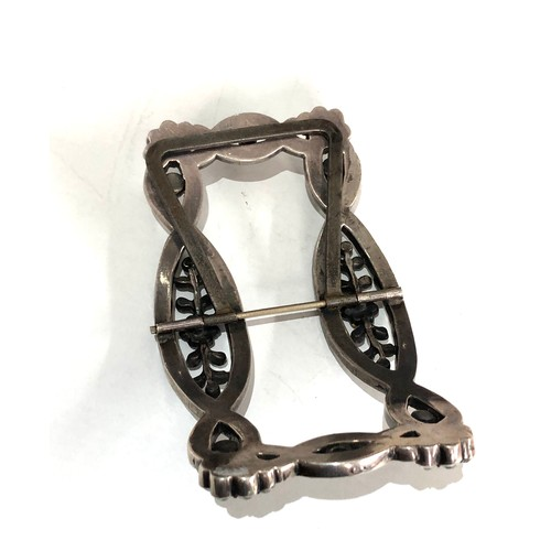 17 - An early 19th century silver and paste buckle measures approx 10.5cm by 6.2cm missing 2 paste stones