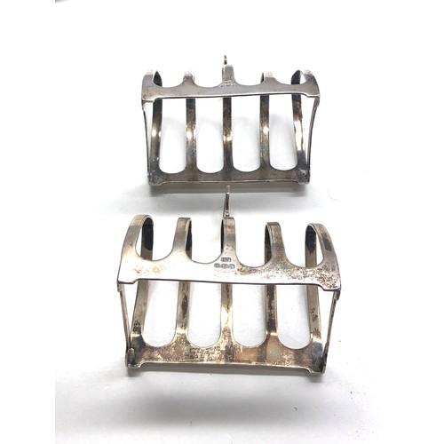 43 - Pair of edward viners silver toast racks Sheffield silver hallmarks weight 107g