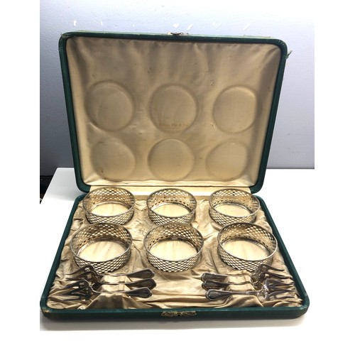 54 - Boxed set of silver pickle bowl holders and forks