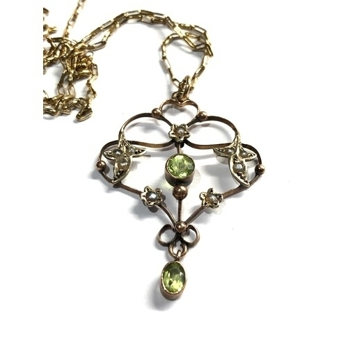 113 - Fine antique 9ct gold peridot and seed-pearl pendant and chain pendant measures approx 4.1cm drop by...