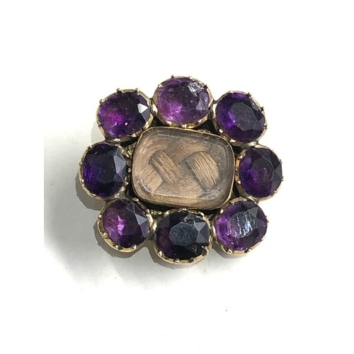 115 - Antique georgian gold amethyst mourning brooch measures approx 2.4cm by 2.2cm weight 5g