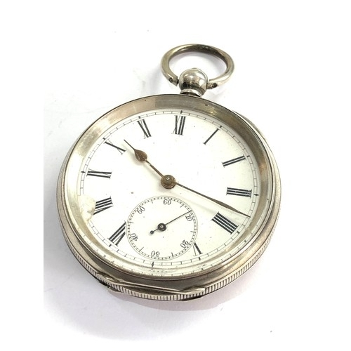 542 - Antique open faced Silver pocket watch ticks but stops no warranty given