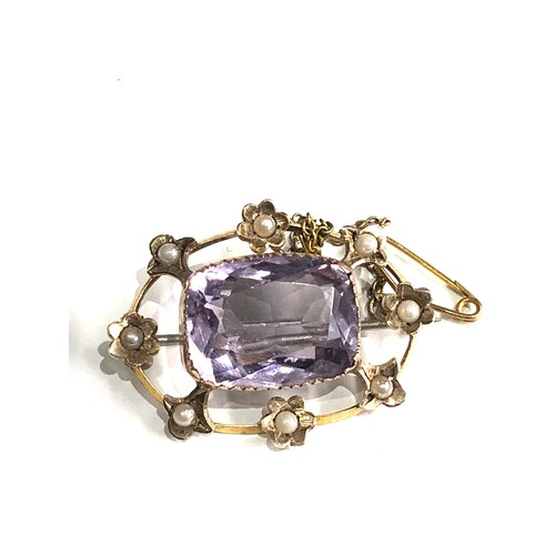 134 - Antique  amethyst and seed-pearl brooch measures approx 3.2cm by 2.4cm