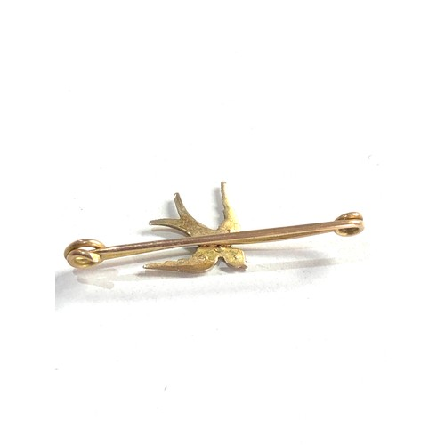 138 - Small antique 9ct gold & seed-pearl swallow bird brooch measures approx 3.1cm missing pearl