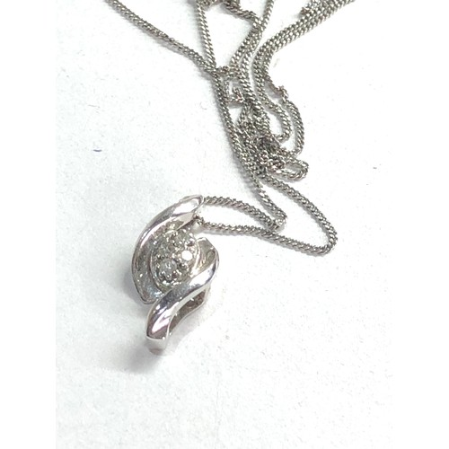 140 - 9ct white gold & diamond pendant necklace weight 1.8g