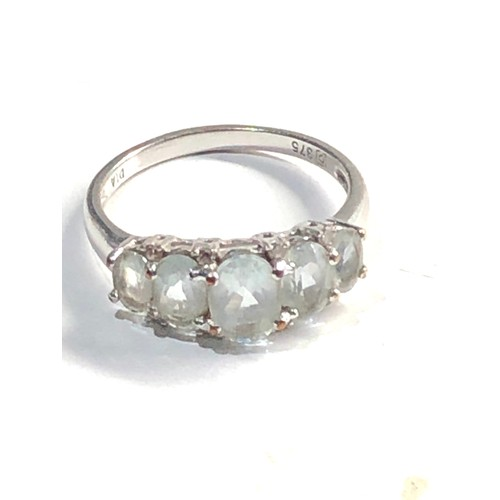 249 - 9ct White gold aquamarine 5 stone ring with diamond accents 2.7g
