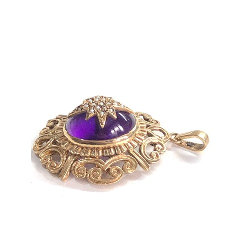 356 - vintage 9ct gold central amethyst with seed pearl starburst design pendant 9.6measures approx 4.4cm ...