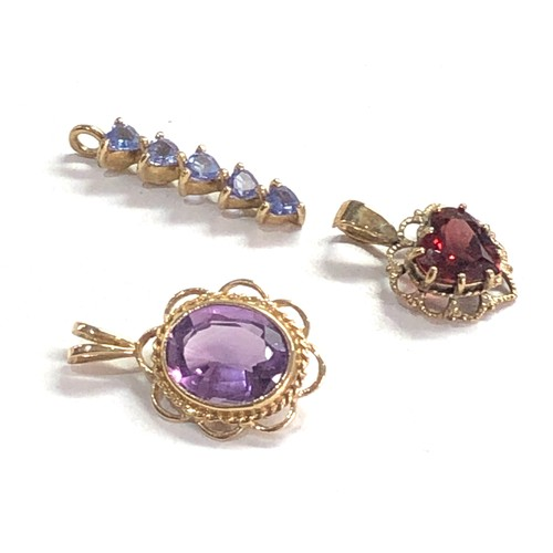 399 - 3 x 9ct Gold gemstone pendants inc. amethyst, tanzanite, garnet