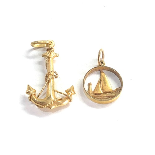 201 - 2 x 9ct gold nautical pendants inc. anchor, boat 2.7g