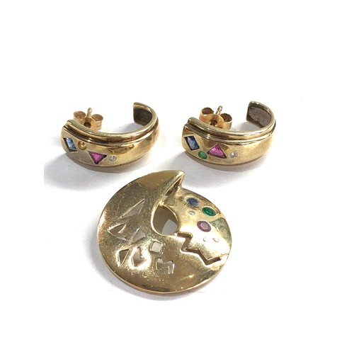 491 - 9ct gold diamond, sapphire, emerald and ruby geometric pendant and half hoop earrings 5.7g one earri...