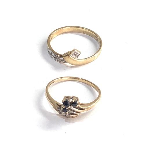 335 - 2 x 9ct gold diamond detail rings inc. sapphire 2.5g