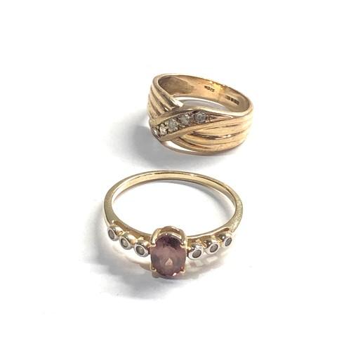 315 - 2 x 9ct gold diamond rings 4.7g