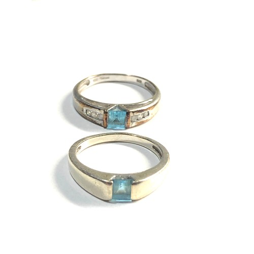 442 - 2 x 9ct White gold rins set with square cut topaz inc. diamond accents 5.3g
