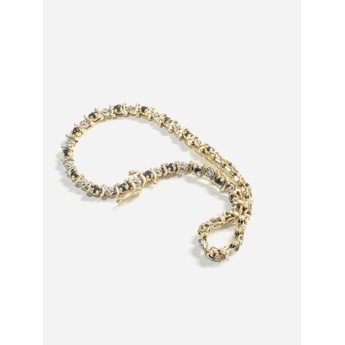 434 - 9ct Gold diamond & sapphire tennis bracelet 6.7g
