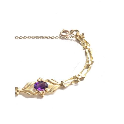 398 - 9ct Gold amethyst ornate panel bracelet 4.8g