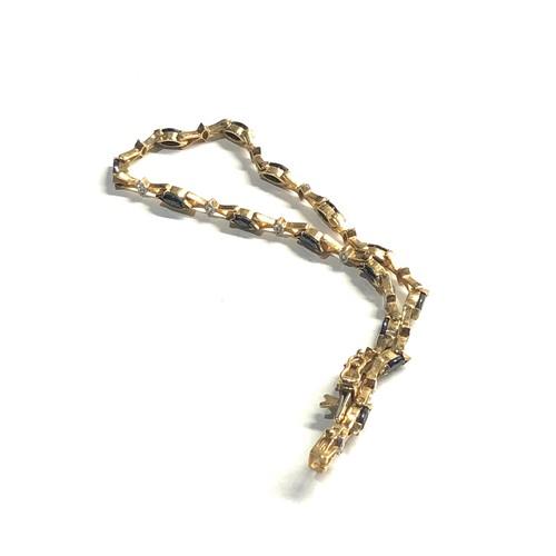 319 - 9ct Gold sapphire & diamond tennis bracelet 5.4g
