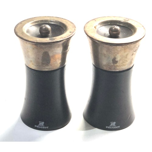 39 - Large pair of silver top pepper mills by peugeot measure approx 12cm tall Birmingham silver hallmark...