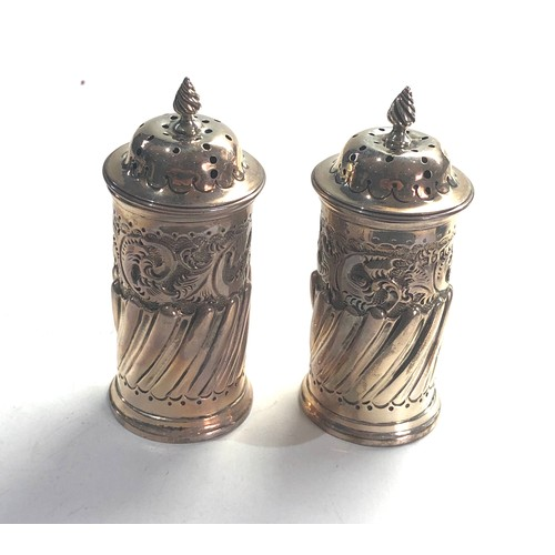 47 - Pair of antique silver peppers London silver hallmarks measure approx 9ct tall weight 100g