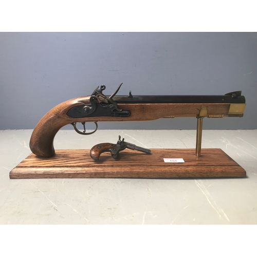 Jukar replica flint lock on stand & small percussion pistol, Flobert