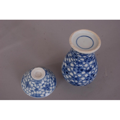 3 - Chinese blue and white baluster vase, painted with prunus on a cracked-ice ground, Kangxi, 17cm high...