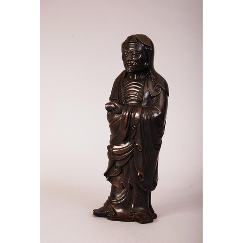 57 - Chinese silver-inlaid bronze figure of Damo, modelled standing barefoot, wearing loose robes reveali...