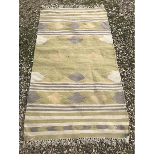 49 - Rug, modern coarse ground rug in yellow and neutral stripes 183x112cm...