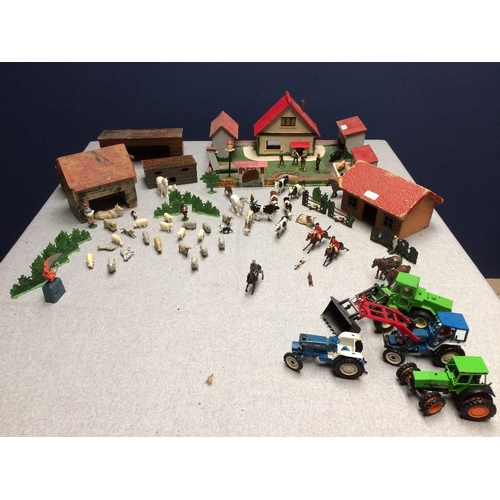 19 - 1950s toy farm, complete with buildings, animals & machinery...