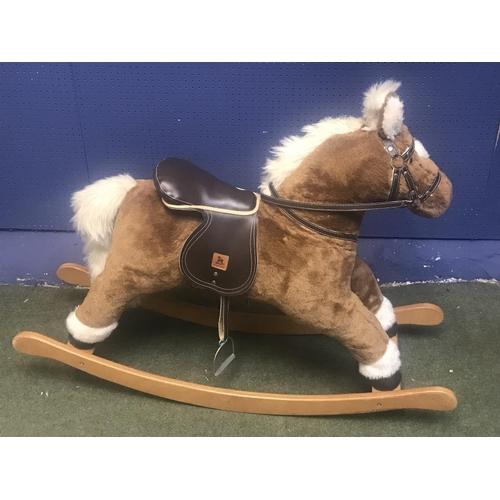 22 - Mamas & Papas rocking horse...