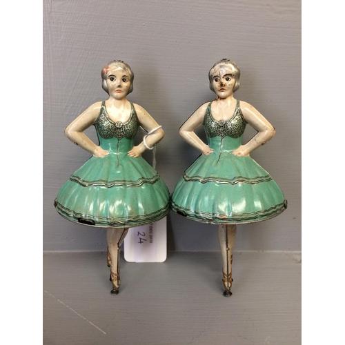 24 - Pair of pirouetting tin plate ballerinas with key...