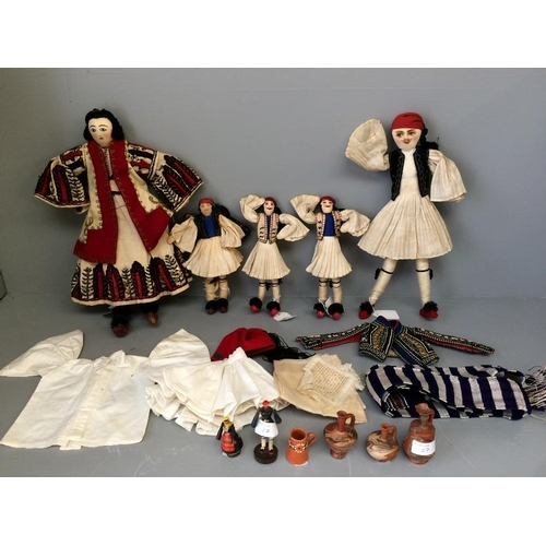27 - 2 large & 3 small vintage souvenir Greek dolls in traditional costumes, complete with spare costumes...