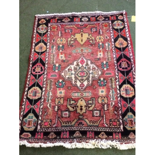 51 - Persian rug with blue centre & black & red borders, 200x140cm...