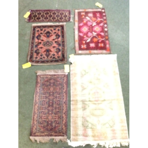 56 - 5 small rugs...