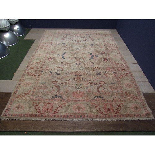 68 - Faded but quality wool rug in pinks & fawns 285x175cm...