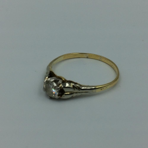 96 - Single stone diamond ring in unmarked yellow & white metal, central brilliant cut diamond approx 0.2...