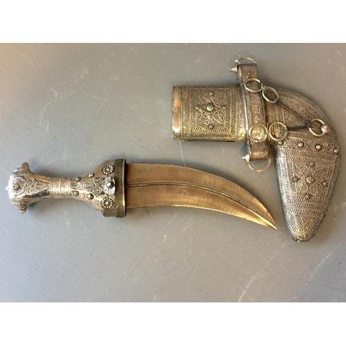 103 - Oman unmarked white metal Jambiya in white metal filigree sheath...
