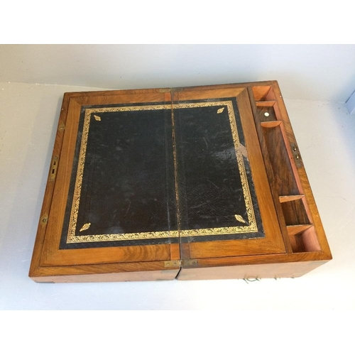 112 - Rosewood and brass bound writing slope with fitted interior...