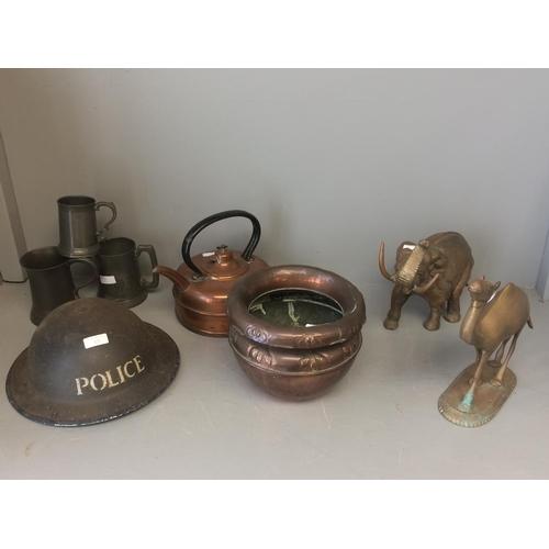 13 - WW II 'Police' steel helmet, copper kettle & copper jardiniere, brass camel & elephant, 3 pewter tan...