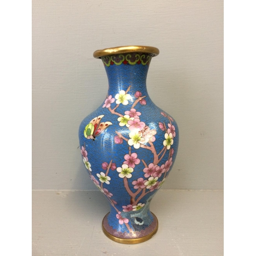 2 - Oriental Cloisonne waisted vase with prunus  & butterfly decoration to a blue ground (damaged)...