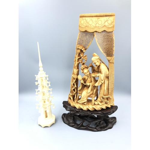 13 - Chinese C19th ivory carving depicting 2 figures on a stand, & ivory carving of a temple (18.5cm) bot...