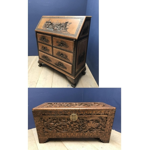 25 - Chinese hardwood bureau the fall flap profusely carved with Chinese scenes, & a camphor wood chest...